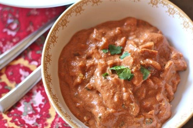 Bowl of paleo chicken tikka masala garnished with cilantro