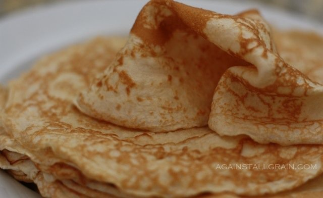 gluten free tortillas folded up on a plate ready to be added to another dish