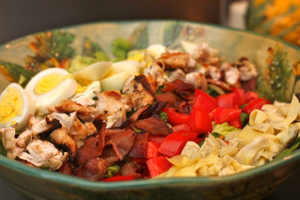 A bowl of Cobb Salad with Basil Vinaigrette.