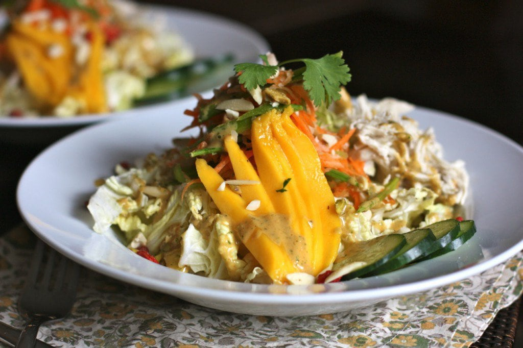Thai Crunch Salad served chilled on a plate loaded with chopped vegetables, mango and delicious dressing!