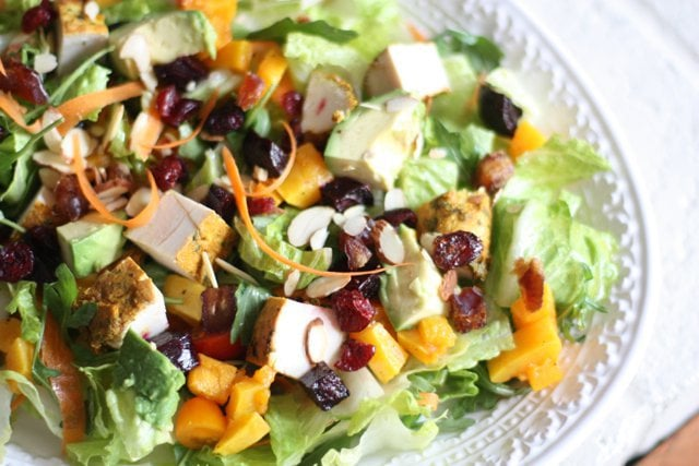 Moroccan Chicken Salad loaded with dates, cranberries and avocado with a champagne vinaigrette.