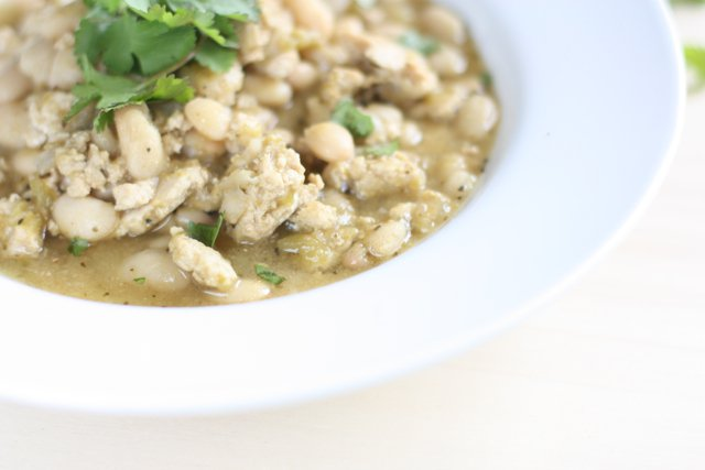A steaming bowl of Green Turkey Chili with White Beans .