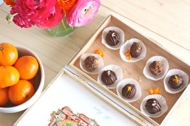 A box of beautifully decorated Dark Chocolate Pink Salt Truffles and Cappuccino Truffles .