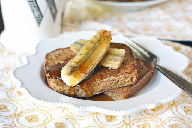A serving of grain free, dairy free French toast with grilled bananas.