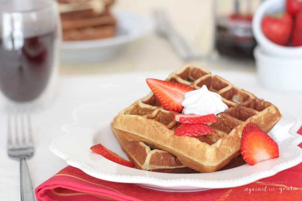 Grain Free Waffles topped with strawberries and cream.