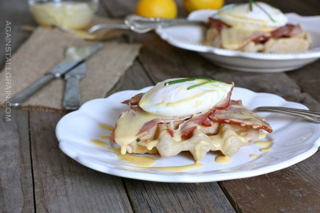 A plate of Eggs Benedict Over Savory Waffles.
