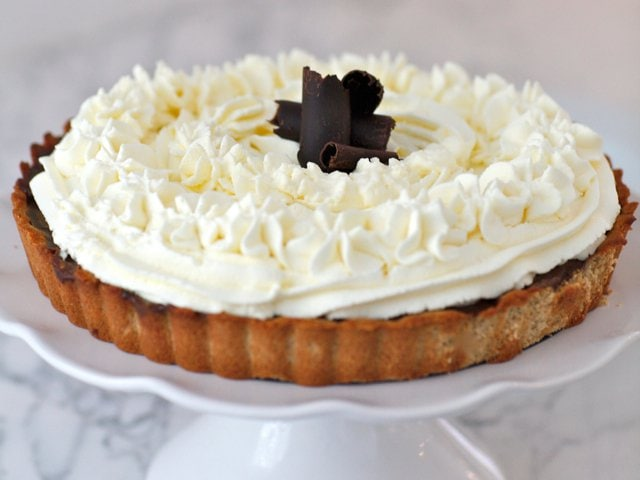 Rich and Creamy Chocolate Pudding Pie topped with coconut milk whipped cream.