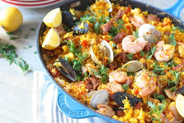 An aromatic pan of mixed seafood paella with cauliflower rice and saffron.