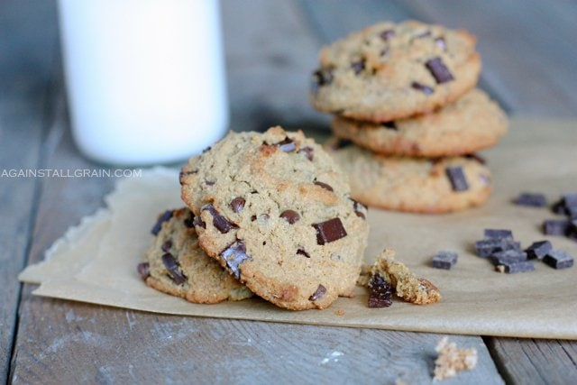 Nut Free 'Peanut' Butter Chocolate Chip Cookies piled high with a glass of milk.