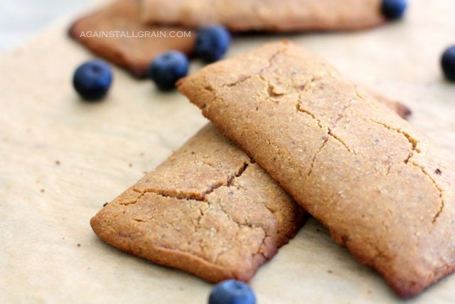 Nutritious and Gluten free 'cereal' bars loaded with blueberry preserves.