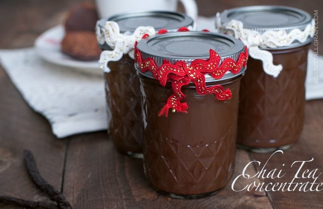 chai tea concentrate in a mason jar with holiday decorations