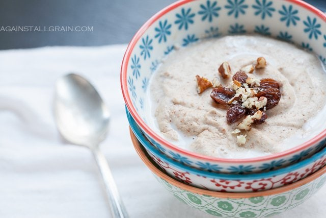 banana nut porridge in a decorative bowl with walnuts on top