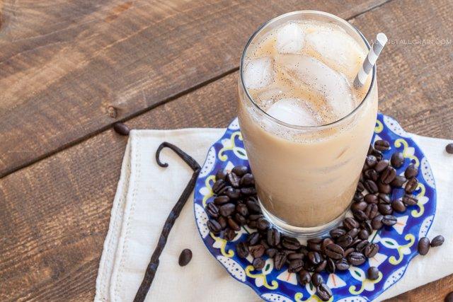 Refreshing glass of vanilla bean iced latte.