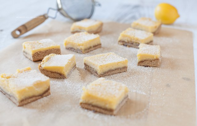 Lucious lemon bars dusted with powdered sugar with just the right amount of tang and sweetness!