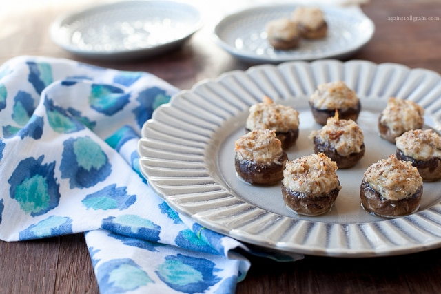 A plate of yummy crab stuffed mushrooms, gluten free and paleo.