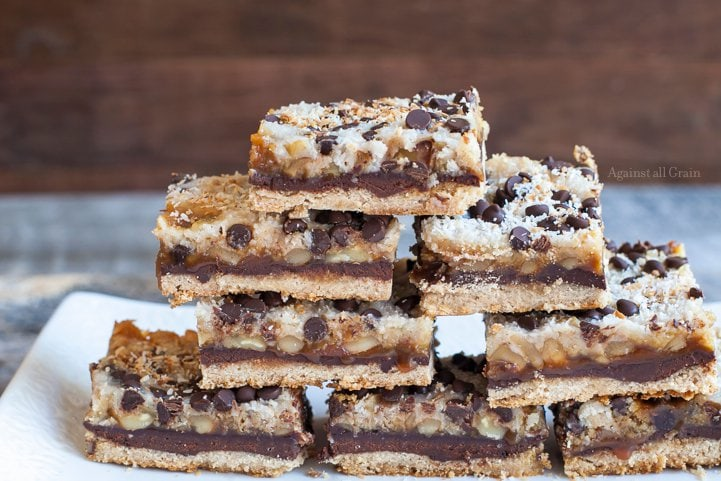 A plate of delicious seven layer bars that are gluten and egg free.