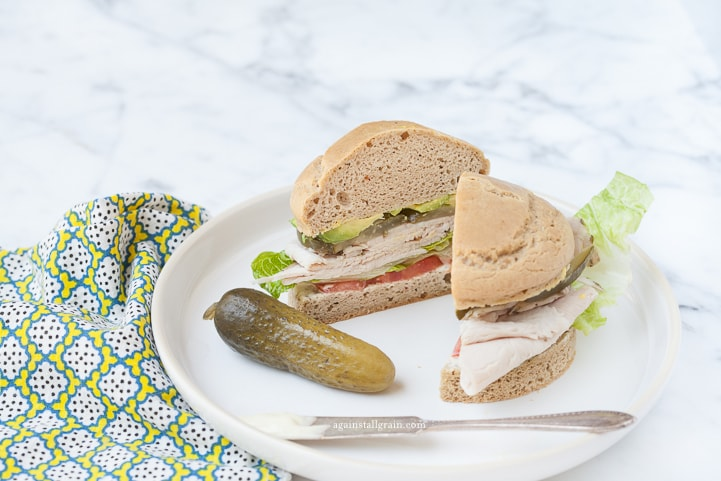 Flaky and delicious gluten free sandwich bun loaded with turkey, tomato and lettuce.