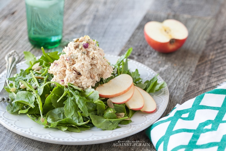 A delicious scoop of Tuna Salad with Apples and Pumpkin Seeds on a bed of lettuce.