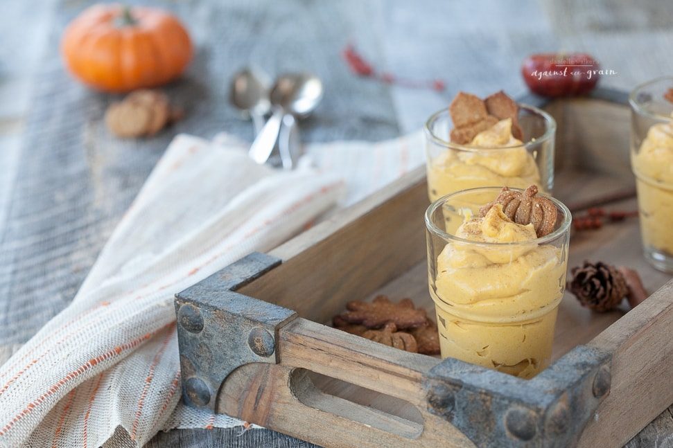 dairy free pumpkin pudding dessert in a small glass cup on a tray
