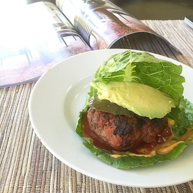 eating_an_awesome_lettuce_wrapped_burger_with_chipotle_mayo__mustard__ketchup__tomato__avocado__and_pickle_over_the_new_drool-worthy__anthropologie_house_and_home_catalog._I_want_every_single_in_there.__aageats__anthropologie__Paleo__grainfree