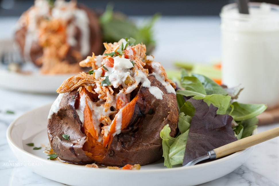 Primal buffalo chicken stuffed sweet potatoes against all grain this time im bringing you these primal buffalo chicken stuffed sweet potatoes with a tangy blue cheese dressing if you havent noticed from my malvernweather Images