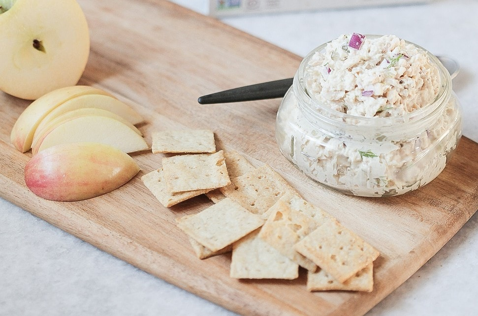 A jar of the best tuna salad (scd and whole30 approved) served with apples and crackers.