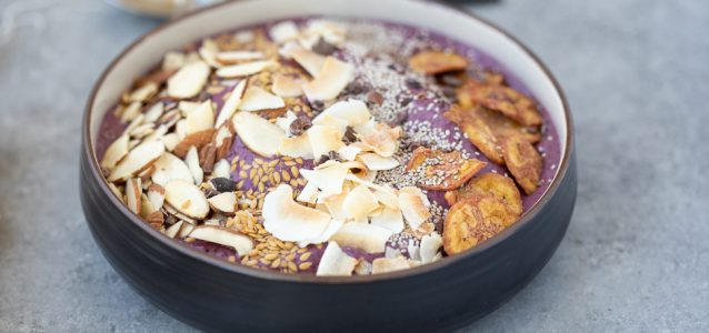 gluten-free acai bowl topped with a variety of grain free options such as almonds, coconut, chia seeds and plantain chips