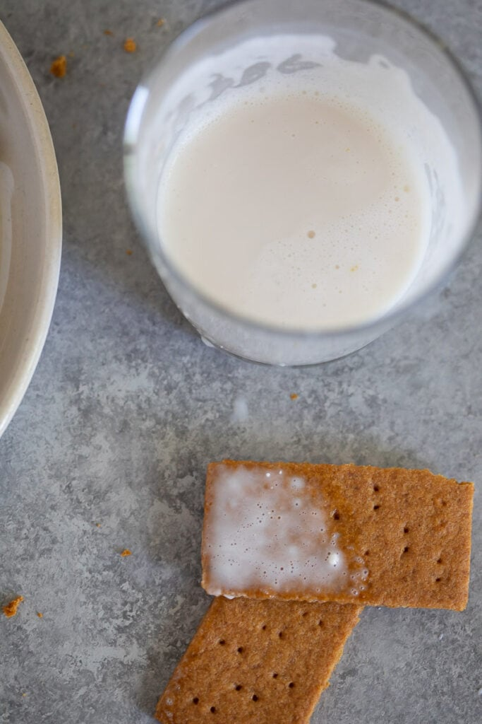Homemade gluten freen graham crackers served with a glass of milk