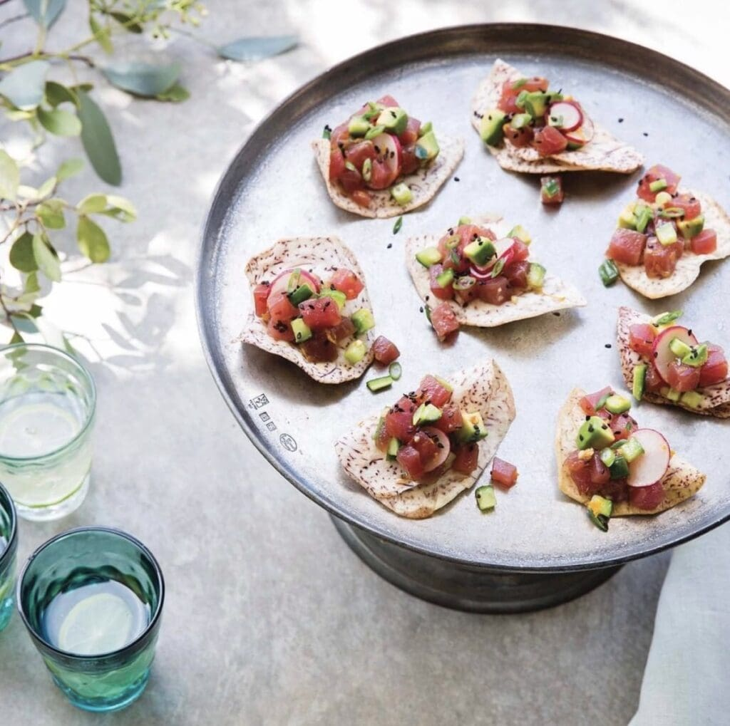 tuna tartare on taro chips displayed on a silver platter